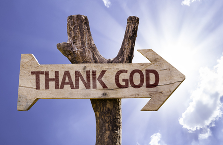 acknowledgment: Thank God sign with arrow on sunny background Stock Photo