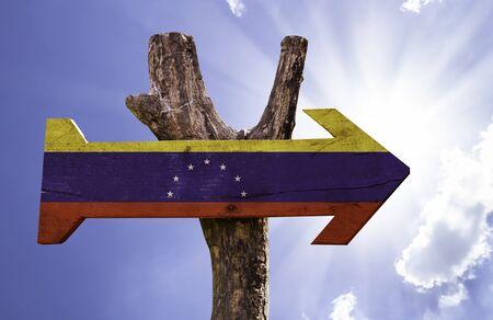 venezuela flag: Venezuela flag sign with arrow on sunny background