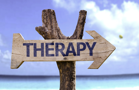 Therapy sign with arrow on beach background