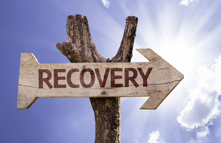 Recovery sign with arrow on sunny background Stock Photo