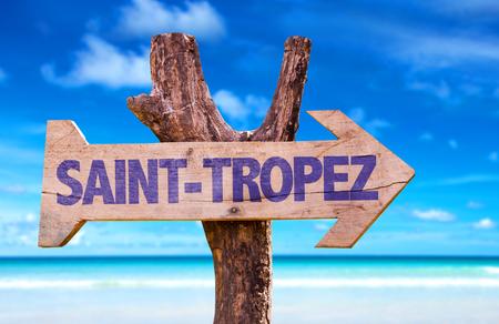 Saint-Tropez sign with arrow on beach background Stock Photo