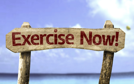 Exercise now! sign with sea background