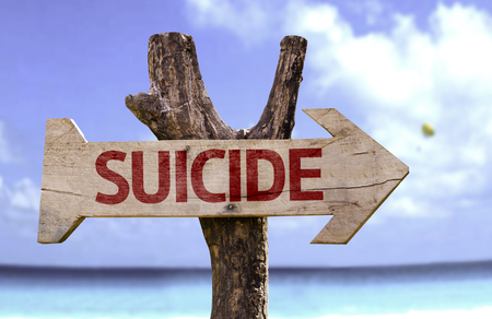 Suicide sign with arrow on beach background