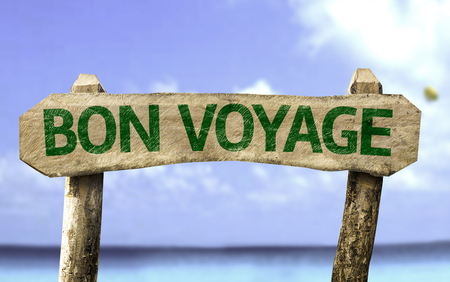 Bon Voyage (have a good trip in French) sign with sea background
