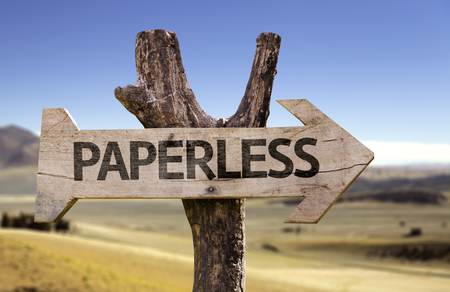 paperless: Paperless sign with arrow on desert background Stock Photo