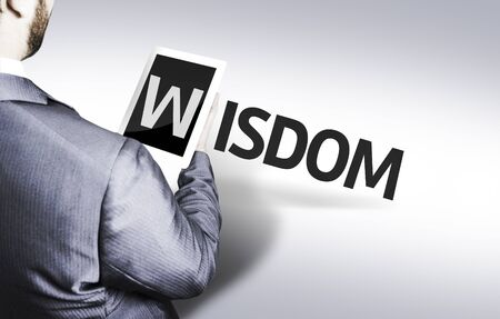 common sense: Business man in low angle view with the text: Wisdom