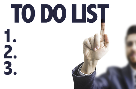 todo list: Business man pointing to transparent board with text: To do list