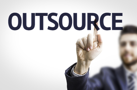 outsource: Business man pointing to transparent board with text: Outsource Stock Photo