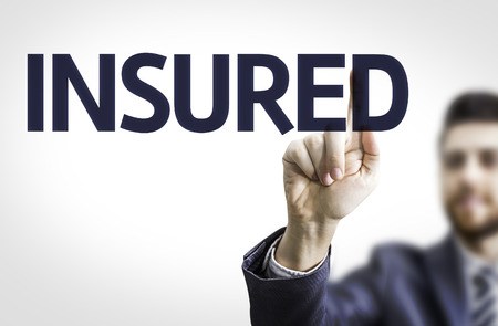insured: Business man pointing to transparent board with text: Insured Stock Photo