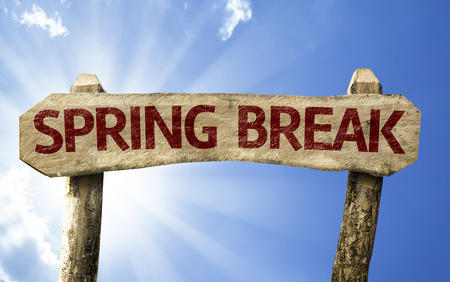 Spring break sign with sunny background