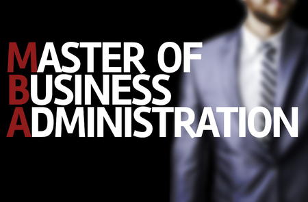 master degree: Business man in black background with the text: Master of Business Administration (MBA) Stock Photo