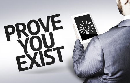 prove: Business man with Tablet Pc and the text Prove You Exist