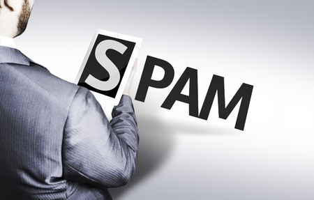 Businessman with the text Spam in a concept image