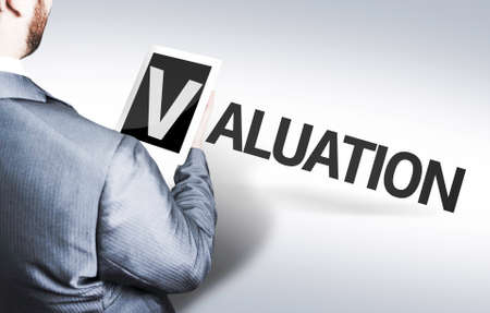 valuation: Businessman with the text Valuation in a concept image Stock Photo