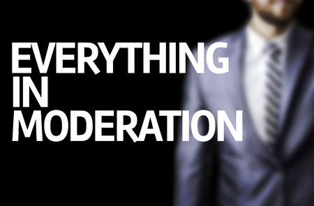 The words Everything In Moderation with businessman background