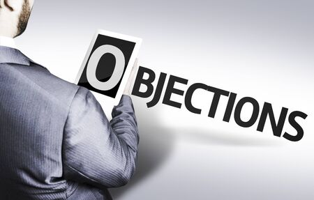 Businessman with Tablet Pc and the text Objections Stock Photo