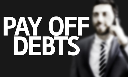 owed: Business man with the text Pay Off Debts in a concept image