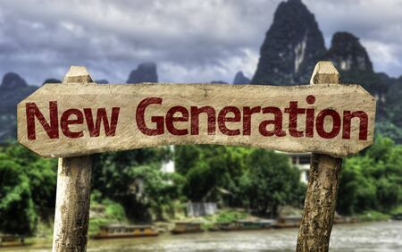 new generation: Wooden sign board with text: New Generation on outdoors background Stock Photo
