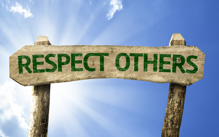 Respect others sign with sunny background