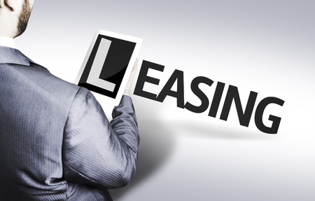 Business man in low angle view with the text: Leasing