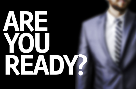anticipate: Business man in black background with the text: Are you ready? Stock Photo