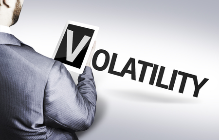 volatility: Business man in low angle view with the text: Volatility