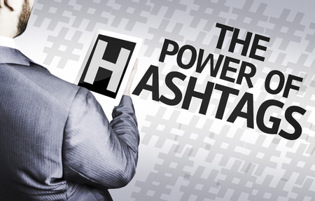 Business man in low angle view with the text: The power of hashtags Stock Photo