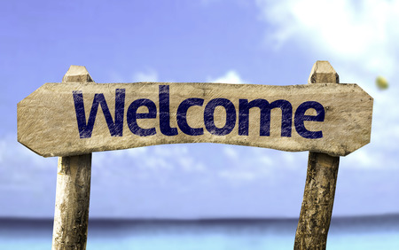 courteous: Welcome sign with sea background
