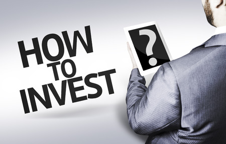 buy shares: Business man in low angle view with the text: How to invest?