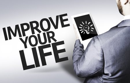 enrich: Business man in low angle view with the text: Improve your life