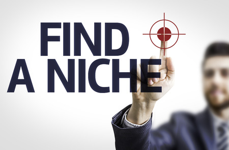 niche: Business man pointing to transparent board with text: Find a niche Stock Photo