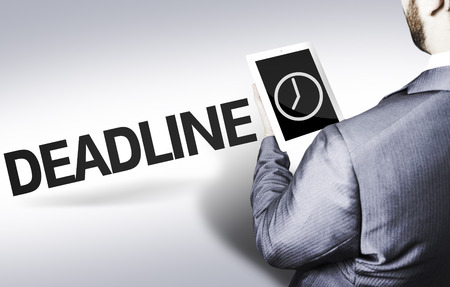 Business man in low angle view with the text: Deadline Stock Photo
