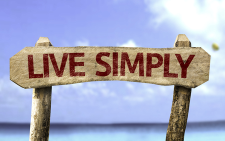 simply: Live simply sign with sea background