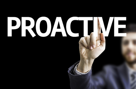 proactive: Business man pointing to black board with text: Proactive