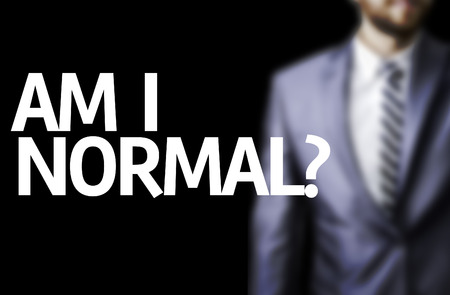 peer pressure: Business man in black background with the text: Am I normal?