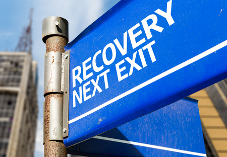 Recovery next exit signpost on building background