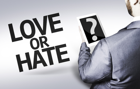 forgiving: Business man in low angle view with the text: Love or hate?