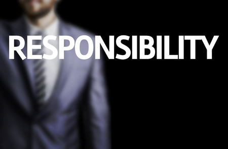 morality: Business man in black background with the text: Responsibility