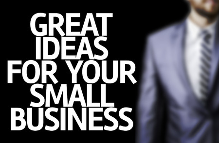 great suit: Business man in black background with the text: Great ideas for your small business Stock Photo