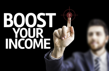remuneraci�n: Business man pointing to black board with text: Boost your income