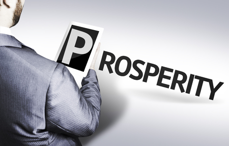 prosperidad: Business man in low angle view with the text: Prosperity