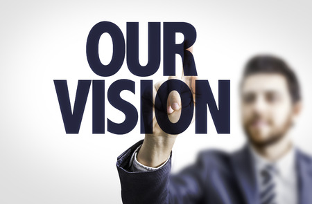Business man pointing to transparent board with text: Our vision Stock Photo