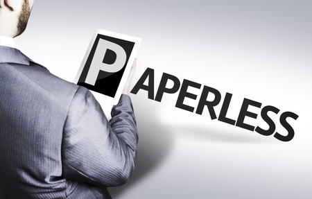 paperless: Business man in low angle view with the text: Paperless