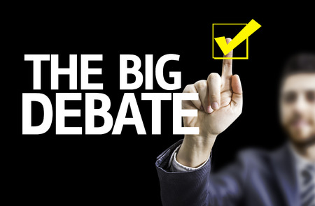 standpoint: Business man pointing to black board with text: The big debate