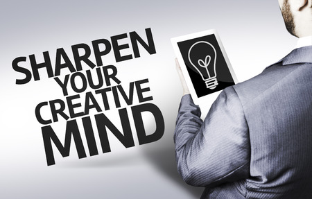 sharpen: Business man in low angle view with the text: Sharpen your creative mind
