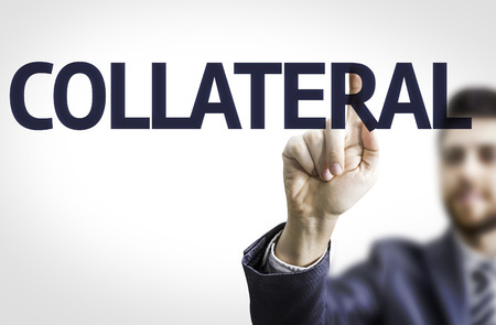Business man pointing to transparent board with text: Collateral Stock Photo
