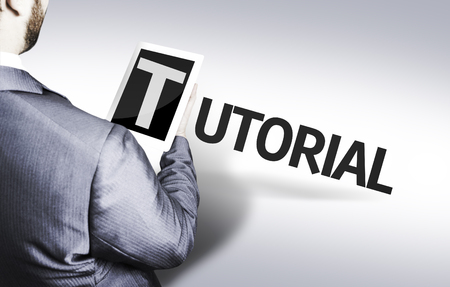 tutorial: Business man in low angle view with the text: Tutorial Stock Photo