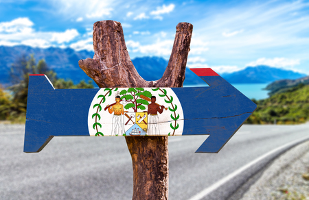 Belize flag sign with arrow on road background Stock Photo
