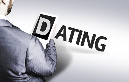 blind date: Business man in low angle view with the text: Dating Stock Photo
