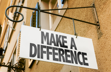 Make a difference signpost on building background 版權商用圖片